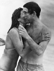 10 Mar 1979, Perth, Australia --- Prince Charles is kissed by Jane Priest, a model, as he emerges from the water at Cottesloe beach in Perth, during his 1979 tour of Australia. --- Image by © Hulton-Deutsch Collection/CORBIS